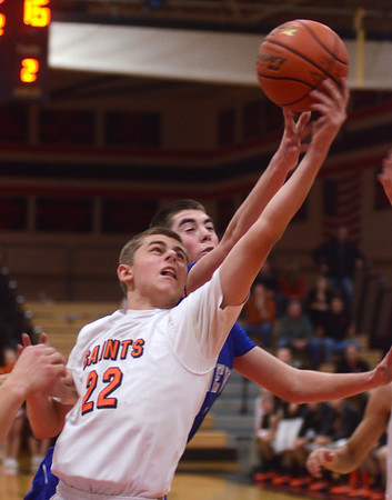 St. Charles East's James McQuillan grabs an offensive rebound during their game against Geneva Friday night. Staff photo by John Cox