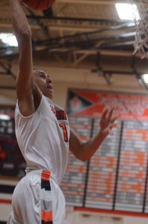 St. Charles East's AJ Washington goes up for the first of his second-half dunks during their game against Geneva Friday night. Staff photo by John Cox