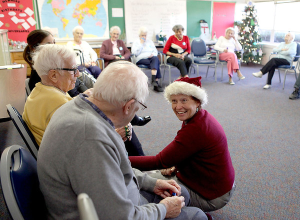 Music Therapist Becky Wellman chats with clients of the Elderday Center in Batavia Wednesday afternoon.