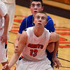 St. Charles East's Ben Skoog boxes out Geneva's Pat McCaffrey during their game t St. Charles East Friday night. Staff photo by John Cox