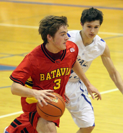 Jeff Krage -- For the Kane County Chronicle<br /> Batavia's Jake Pollack drives around Larkin's Taylor Boley during Saturday's game in Elgin.<br /> Elgin 12/8/12