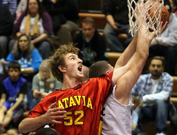 Jeff Krage -- For the Kane County Chronicle<br /> Batavia's Luke Horton battles for a rebound during Saturday's game at Larkin.<br /> Elgin 12/8/12