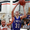 Jeff Krage -- For the Kane County Chronicle<br /> Geneva's Sami Pawlak shoots over St. Charles East's Katie Claussner during Thursday's game at St. Charles East.<br /> St. Charles 12/6/12