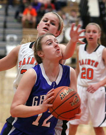Jeff Krage -- For the Kane County Chronicle<br /> Geneva's Ellen Dwyer draws a foul on St. Charles East's Hannah Nowling on her to the basket during Thursday's game at St. Charles East.<br /> St. Charles 12/6/12