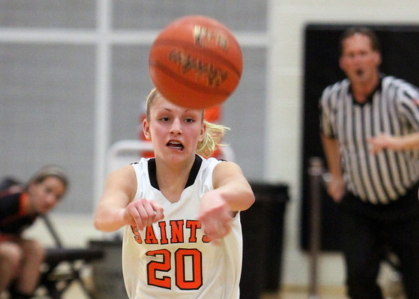 Jeff Krage -- For the Kane County Chronicle<br /> St. Charles East's Katie Claussner passes the ball during Thursday's game against visiting Geneva.<br /> St. Charles 12/6/12