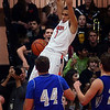 St. Charles East's AJ Washington slams home one of two second-half dunks during their game against Geneva Friday night. Staff photo by John Cox