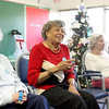 (Left to right) Clients Lydia, Vera and Dolores ring bells along with the music during a music therapy session at the Elderday Center in Batavia Wednesday afternoon.