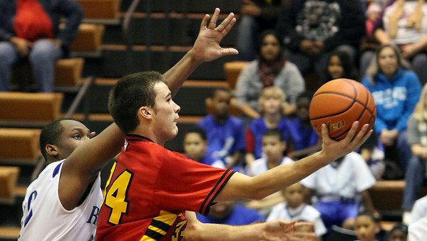 Jeff Krage -- For the Kane County Chronicle<br /> Batavia's Zach Strittmatter goes up for a shot during Saturday's game at Larkin.<br /> Elgin 12/8/12