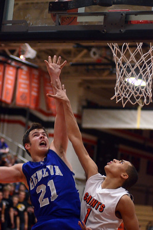 Geneva's Mike Trimble goes up for a shots during the Vikings' game at St. Charles East Friday night. Staff photo by John Cox