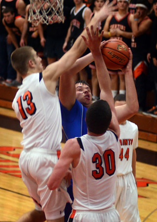 Geneva's Connor Chapman goes up for a shots during the Vikings' game at St. Charles East Friday night. Staff photo by John Cox