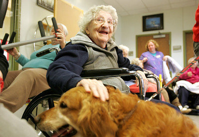 Monica Maschak - mmaschak@shawmedia.com Valley Hi resident Pat Morre pets Abby, the dog, during a monthly animal-assisted therapy visit on Tuesday, December 11, 2012.