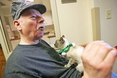 Monica Maschak - mmaschak@shawmedia.com LeRoy Schamper holds Jasmine, a cat from the Assisi Animal Foundation, at the Valley Hi nursing home on Tuesday, December 11, 2012.