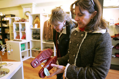 Monica Maschak - mmaschak@shawmedia.com Barb Podraza (left) and Gina McGuire look at shoes at the Green Box Boutique in the Woodstock Square on Wednesday, December 12, 2012.  The friends came to the square to shop for gifts and ornaments.