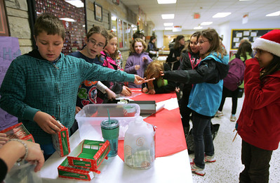 Monica Maschak - mmaschak@shawmedia.com Students from the Leadership Club at the Duker School in McHenry sell candy cane grams before the start of classes on Thursday, December 13, 2012. The proceeds from the candy cane grams will go toward purchasing gift cards for families in need around Christmastime.