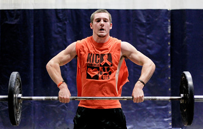 Sarah Nader - snader@shawmedia.com Crystal Lake Central's Isaiah Mosher, 18, lifts weights while training at Elite 7 in Lake Barrington on Thursday, December 13, 2012. Mosher and several other local high school football players are taking part in the year-round specialized training to become better players.