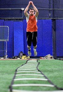 Sarah Nader - snader@shawmedia.com McHenry's Nate Rueckemann, 18, runs a drill while training at Elite 7 in Lake Barrington on Thursday, December 13, 2012. Several local high school football players are taking part in the year-round specialized training to become better players.