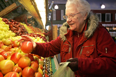 Monica Maschak - mmaschak@shawmedia.com Maria Wroblewski selects apples from the produce section at Joe Caputo and Sons Fruit Market in Algonquin on Friday, December 14, 2012.  In 2013, food prices are expected to increase, especially for beef, poultry and fresh fruit.