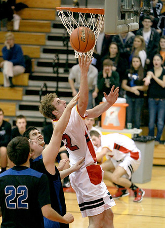Luke Horton of Batavia attempts a shot during their home game against St. Charles North Thursday night.
