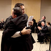 Rene Cruz of Aurora embraces his father, Florencio Cruz, after he was sworn in as the first Hispanic judge in Kane County during a ceremony Thursday at the Kane County Branch Court in St. Charles.