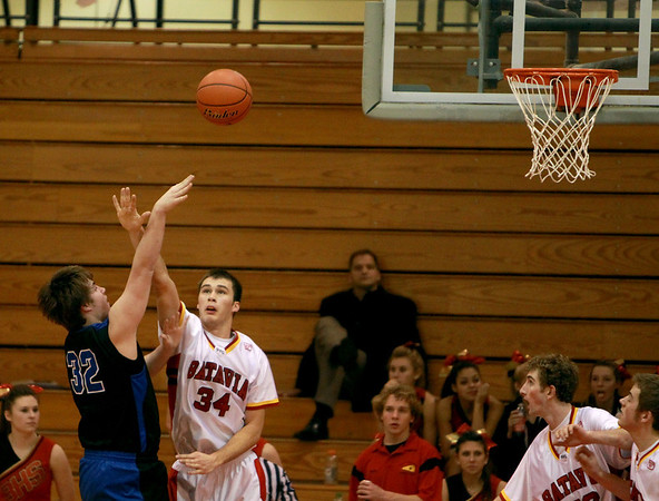 Batavia's Zach Strittmatter (34) tries to block a shot by St. Charles North's Jack Callaghan during their game at Batavia Thursday night.