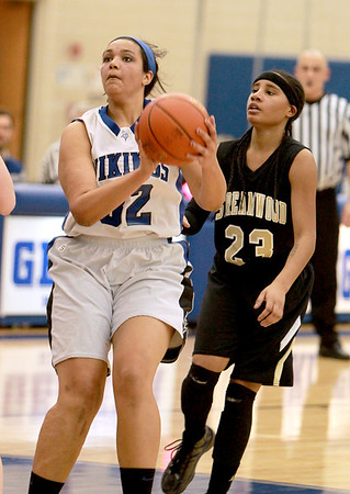 Geneva's Sidney Santos looks for a shot during their home game against Streamwood Wednesday night.