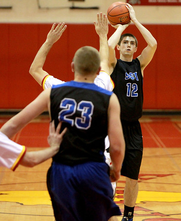 St. Charles North's Quinten Payne attempts a shot during their game at Batavia Thursday night.