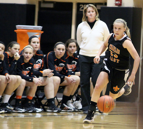 Jeff Krage – For the Kane County Chronicle<br /> St. Charles East's Hannah Nowling brings the basketball up the court during Tuesday's game at Streamwood High School.<br /> Streamwood 12/11/12