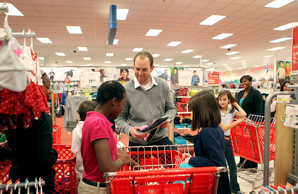 Chicago Bears kicker Robbie Gould talks with Mooseheart students as they shop for gifts at Target in St. Charles. Over 80 Mosseheart students were each given $100 to spend courtesy of the Goulden Touch charity.
