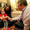 William Whiston, 17 months, with his parents, Melanie and Dan, in their Geneva home. William was born with myotubular myopothy, a rare genetic disorder that does not allow him to move his muscles with any force.