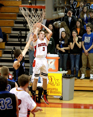 Batavia's Jake Pollack lines up his shot during their home game against St. Charles North Thursday night.