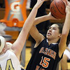 Jeff Krage – For the Kane County Chronicle<br /> St. Charles East's Kyra Washington takes a shot over Streamwood's Hannah McGlone during Tuesday's game at Streamwood High School.<br /> Streamwood 12/11/12