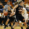 Jeff Krage – For the Kane County Chronicle<br /> St. Charles East's Carly Pottle heads toward the basket during Tuesday's game at Streamwood High School.<br /> Streamwood 12/11/12