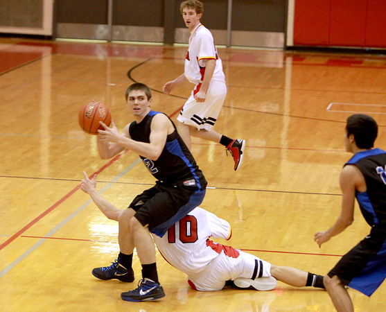 St. Charles North's Quinten Payne grabs a loose ball to make a pass during their game at Batavia Thursday night.