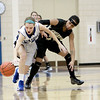 Geneva's Morgan Seberger (left) gets past Streamwood's Deja Moore to grab a loose ball during their game at Geneva Wednesday night.