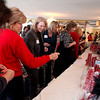 Batavia Women in Business members look over raffle items during the BWIB Holiday Networking Luncheon at the Fox Valley Country Club in North Aurora Tuesday.