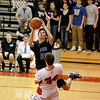 Kyle Swanson of St. Charles North goes up for a shot over Batavia's Zach Strittmatter (34) during their game at Batavia Thursday night.