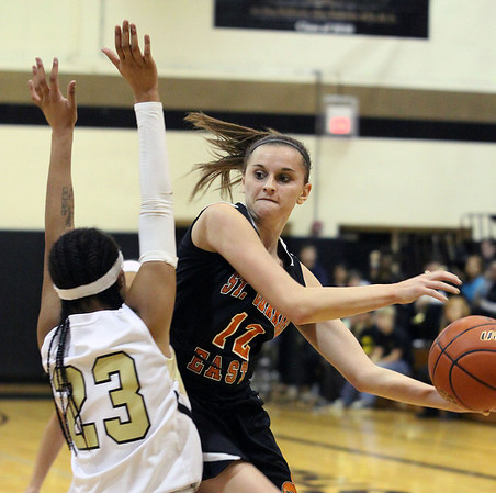Jeff Krage – For the Kane County Chronicle<br /> St. Charles East's Paige Jordan passes the ball around Streamwood's Deja Moore during Tuesday's game at Streamwood High School.<br /> Streamwood 12/11/12