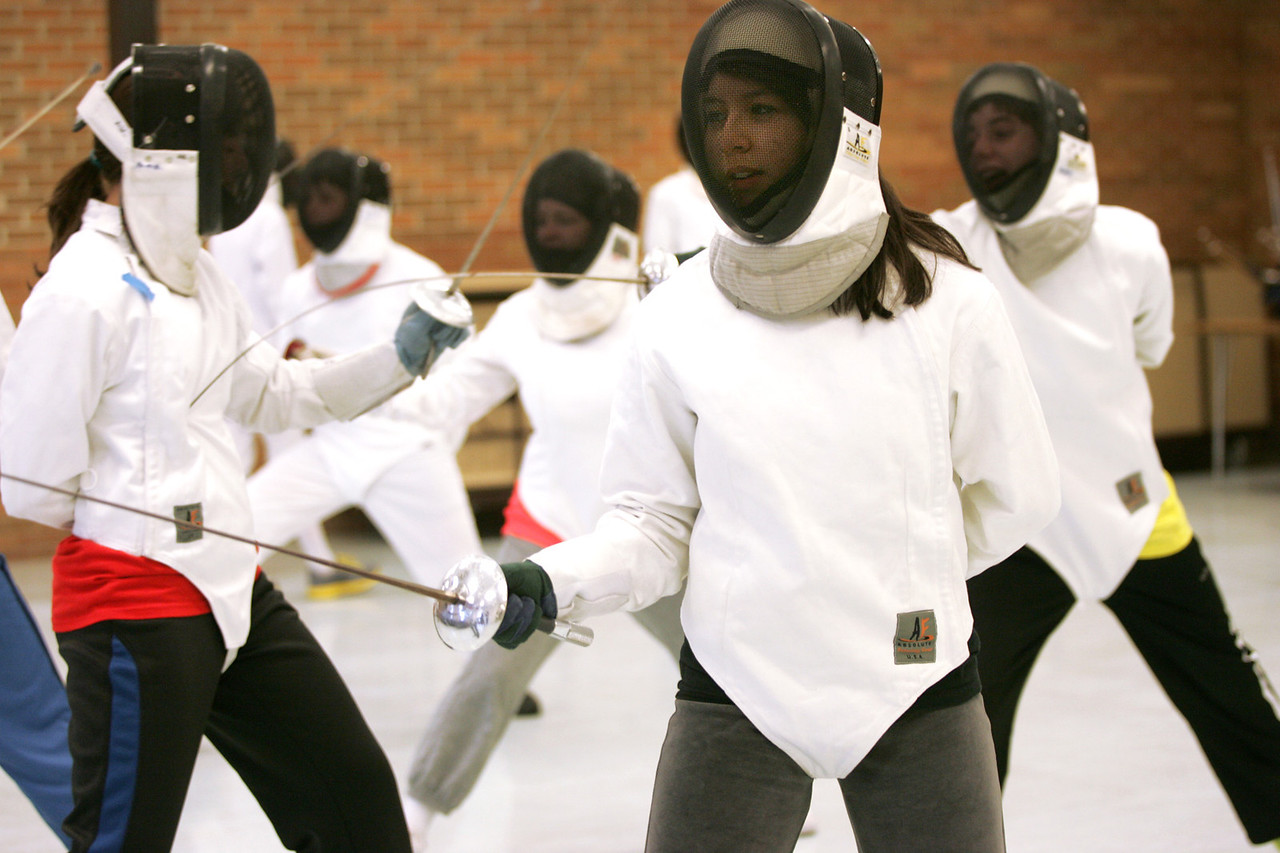 Monica Maschak - mmaschak@shawmedia.com Sheila Sagear spars with other members of Marian Central's fencing club during a practice on Monday, December 17, 2012.  The sport is not covered by the IHSA, meaning the students must self-support the program.  Marian Central, as well as other high schools in Illinois, Wisconsin and Indiana with a fencing club, all meet twice durng the season.