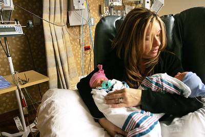 Monica Maschak - mmaschak@shawmedia.com Mother Jeannie Roy holds her week and a half old twins Holly (left) and James in the Special Care Nursery at the Advocate Good Shepherd Hospital in Barrington on Monday, December 17, 2012.  The twins had just graduated to open cribs that morning, making it one step closer to getting discharged.
