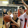 Jeff Krage -- For the Kane County Chronicle<br /> St. Charles East's Ben Skoog looks for a shot while being defended by Batavia's Zach Strittmatter during Saturday's game in Batavia.<br /> Batavia 12/15/12