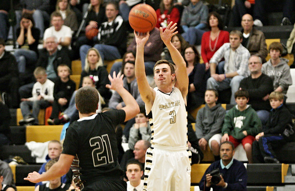Rob Winner – rwinner@shawmedia.com<br /> <br /> Sycamore's David Compher takes a 3-point shot during the first quarter in a game against Kaneland in Sycamore, Ill., Saturday, Dec. 8, 2012.