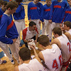 Marmion Cadets head coach Ryan Paradise draws up a play for his team against the Wheaton Warriors at Marmion in Aurora, IL on Friday, December 14, 2012 (Sean King for The Kane County Chronicle)
