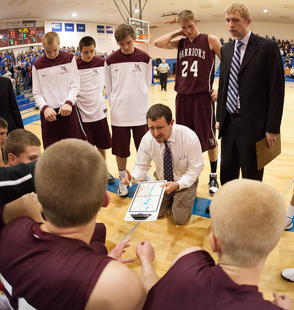 Wheaton Warriors head coach Paul Fergguson talks to his team during a time out against Marmion at Marmion in Aurora, IL on Friday, December 14, 2012 (Sean King for The Kane County Chronicle)