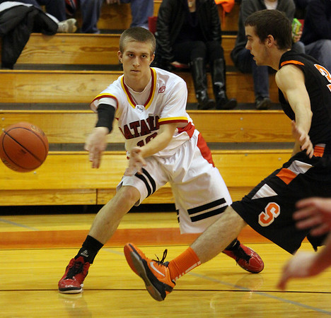 Jeff Krage -- For the Kane County Chronicle<br /> Batavia's Mike Rueffer passes the basketball inside during Saturday's game against visiting St. Charles East.<br /> Batavia 12/15/12