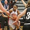 Rob Winner – rwinner@shawmedia.com<br /> <br /> DeKalb's Brittney Patrick (center) makes a move toward the basket during the second quarter in DeKalb, Ill., Tuesday, Dec. 11, 2012. DeKalb defeated Kaneland, 31-17.