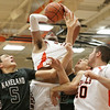 Rob Winner – rwinner@shawmedia.com<br /> <br /> DeKalb's Andre Harris takes a shot during the second quarter in DeKalb, Ill., Friday, Dec. 14, 2012. Kaneland defeated DeKalb, 50-45.
