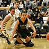 Rob Winner – rwinner@shawmedia.com<br /> <br /> Kaneland's Tyler Carlson (right) loses the ball after being pressured by Sycamore's Devin Mottet during the first quarter in Sycamore, Ill., Saturday, Dec. 8, 2012.