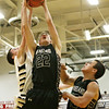 Rob Winner – rwinner@shawmedia.com<br /> <br /> Kaneland's Dan Miller (22) goes up for an offensive rebound during the second quarter in Sycamore, Ill., Saturday, Dec. 8, 2012.
