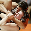 Rob Winner – rwinner@shawmedia.com<br /> <br /> Kaneland's Nick Sharp (top) attempts to pin DeKalb's Damon Dombek during their 220-pound match in DeKalb, Ill., Thursday, Dec. 6, 2012. DeKalb defeated Kaneland, 50-23.