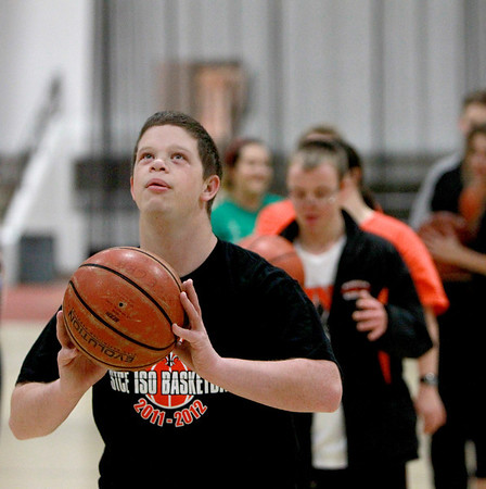 Daniels Walsh shoots the ball during practice with the St. Charles East Fighting Saints Special Olympics basketball team.